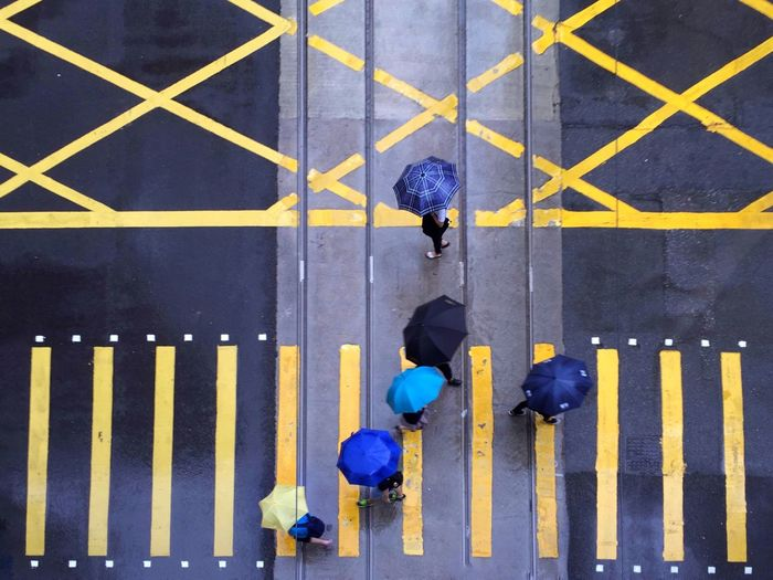 Directly Above Shot Of People Walking On Street During Monsoon