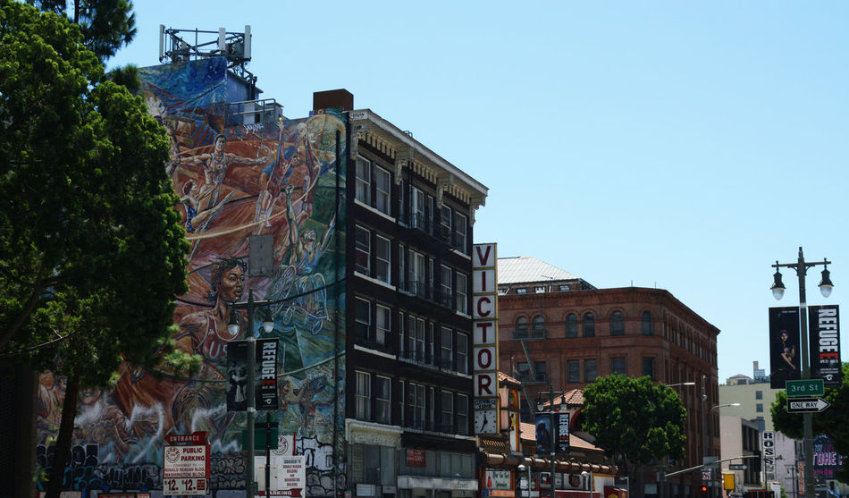 Architecture Building Exterior Built Structure City City Street Clear Sky Colors Day Los Angeles, California Mural Art Murales No People Outdoors Perspective Sky Street Tree