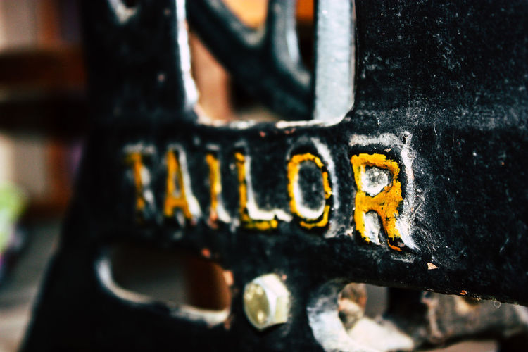 Close-up of text on rusty metal