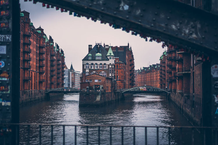 Speicherstadt, city of warehouse, with steel bridge and the canal in cloudy day, hamburg