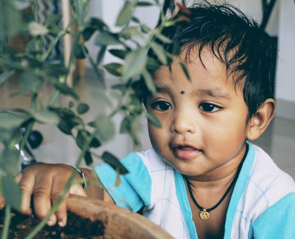 If new genertion will show this kind of love towards nature, we can stop global warming!! Globalwarming Portrait Child Lifestyles Headshot Looking At Camera Childhood Human Face One Person Close-up People Leisure Activity Human Body Part Indoors  Human Hand Day Adult Love Nature Affection The Portraitist - 2017 EyeEm Awards
