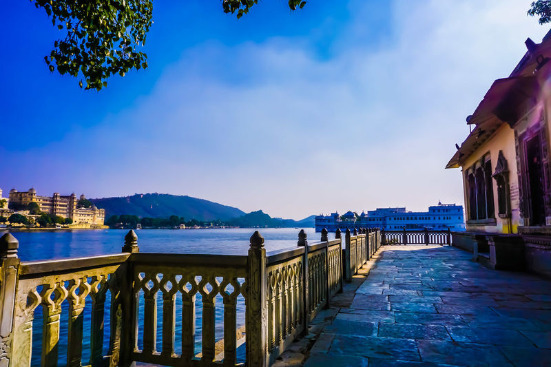 UDA UDAIPUR,RAJASTHAN Udaipur. India Architecture Beauty In Nature Blue Building Exterior Built Structure Day Lake Mountain Nature No People Outdoors Scenics Sea Sky Udaipur Water