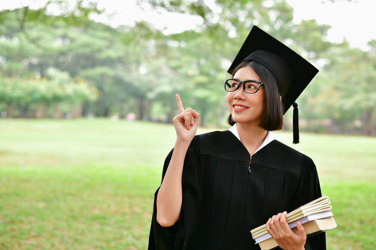 Beautiful Happiness Achievement Beauty Education Educational Focus On Foreground Front View Graduation Graduation Gown Holding Mortarboard One Person Outdoors Portrait Real People Standing Student Studying Success University University Student Waist Up Young Adult Young Women