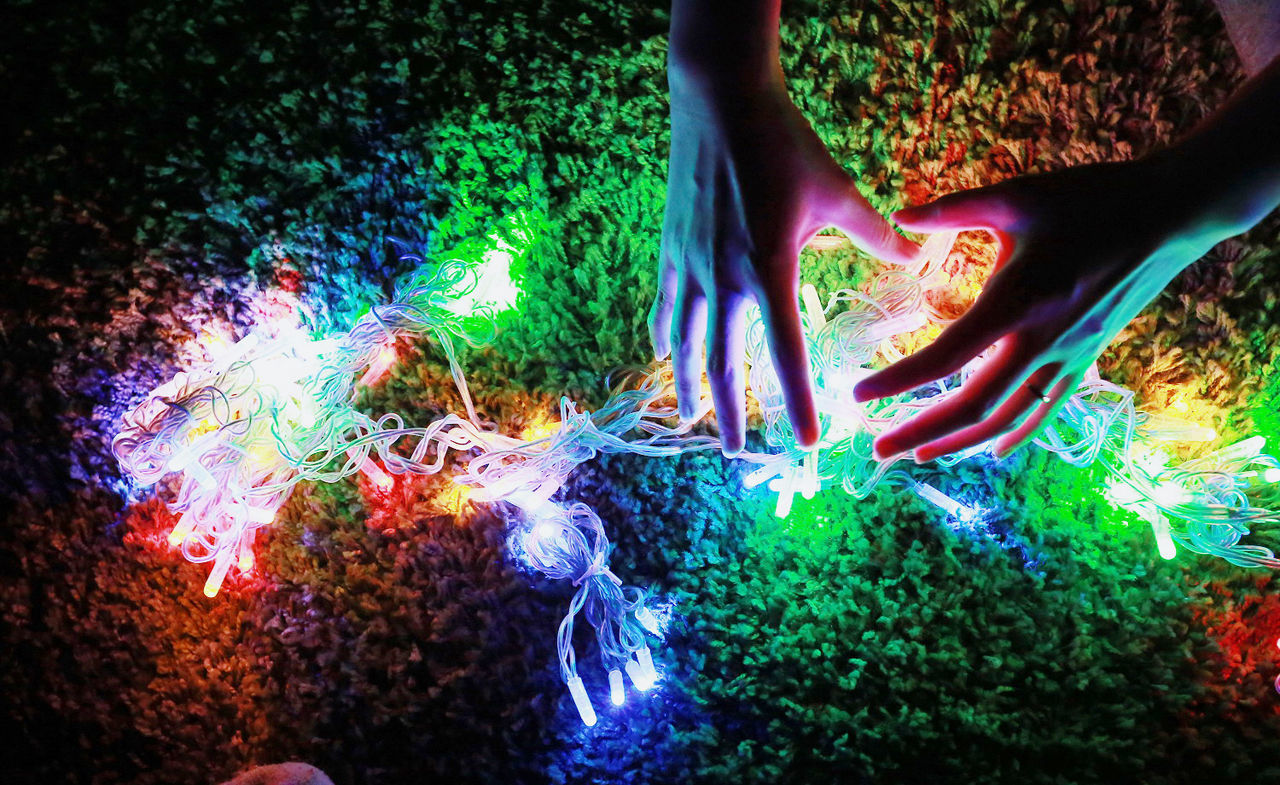 human hand, human body part, multi colored, one person, high angle view, illuminated, real people, indoors, night, close-up, people