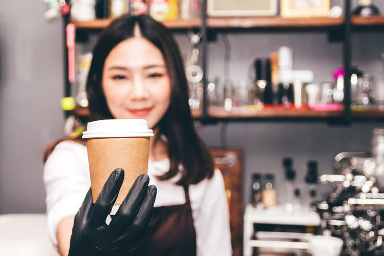 Barista holding coffee in coffee shop Adult Beautiful Woman Cafe Coffee Coffee - Drink Coffee Cup Cup Drink Drinking Food And Drink Front View Hairstyle Holding Indoors  Looking At Camera Mug One Person Portrait Real People Refreshment Women Young Adult