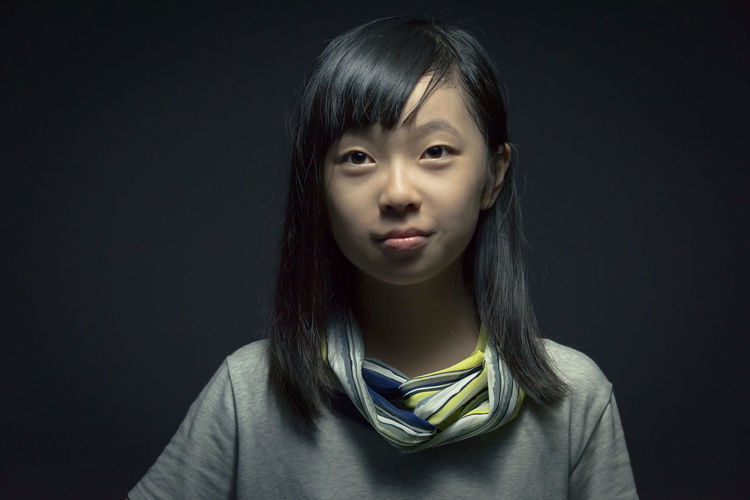Asian girl portrait at studio light Dark Hope Kindness Proud Thinking Asian Girl Black Background Black Hair Childhood Chinese Clever Close-up Delight  Front View Good Headshot Indoors  Looking At Camera One Person People Portrait Real People Smile Smiling Studio Shot