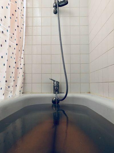 Water Filling In Bathtub At Bathroom