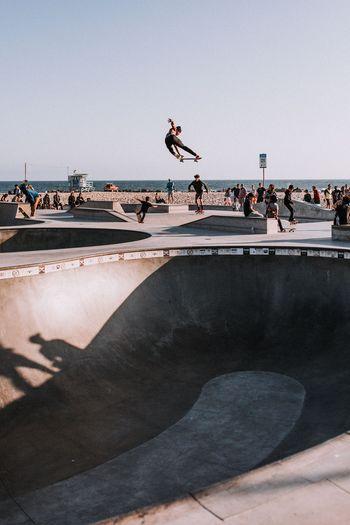 Man Performing Stunt At Skateboard Park