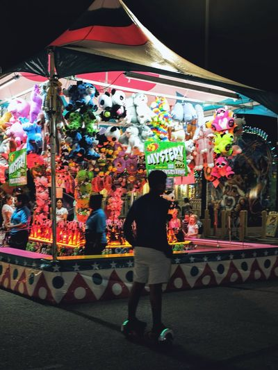 Nebraska State Fair - Grand Island, Nebraska August 2016 A Day In The Life Americans Camera Work Carnival Color Photography Cultures EyeEm Gallery Fairground Flash Photography Fuji X100s Full Length Getty Images Hover Board Illuminated Lifestyles Mode Of Transport Nebraska Nightphotography Photo Essay State Fair Storytelling Streetphotography Summertime Teenager Wheels