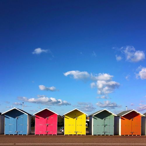 Beach Huts Seaside Eastbourne Blue Sky And Clouds negative space Sky Built Structure Architecture Cloud - Sky Beach Hut Multi Colored Building Exterior Hut Side By Side Beach In A Row No People