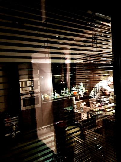 Reflection of illuminated window in store