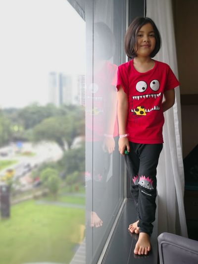EyeEm Selects Window Red Shirt Pretty Girl Standing Child Childhood One Girl Only Front View One Person Standing