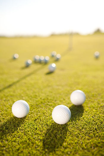 Close-Up Of Balls On Golf Course
