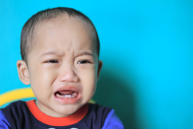 Close-up portrait of crying boy