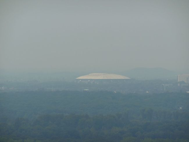 The 'Halde Hoheward' is a man made mountain in the Ruhr Area with the top 113m above sea level. It is landfill coming from Zeche Recklinghausen, Zeche Ewald and Zeche General Blumenthal/Haard. In the far distance the stadium of Schalke04. Dortmund Fussball Gelsenkirchen Schalke04 Halde Hoheward Mountain Scenics Sky