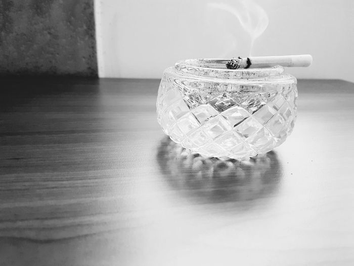 Close-up of cigarette on table