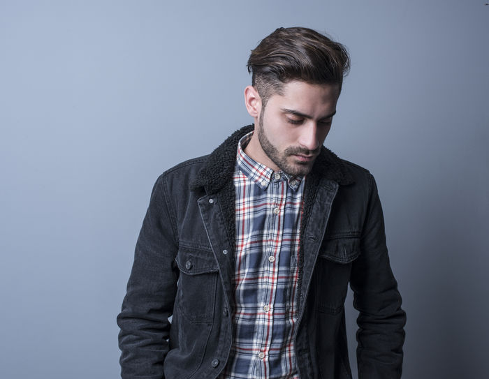 Attractive man in studio shot 20 Years Old Adult Man Adult Adults Background Beard Bearded Beautiful People Casual Clothing Checked Pattern Contemplation Facial Hair Front View Gray Gray Background Handsome Indoors  Indoors  Lifestyles Looking Male One Person People Shot Standing Studio Shot Waist Up Young Adult Young Men