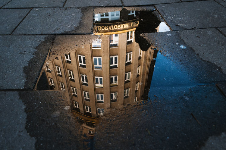 Reflections Architecture Close-up Day High Angle View Lid Manhole  No People Outdoors Puddle Puddleography Reflection Street Paint The Town Yellow