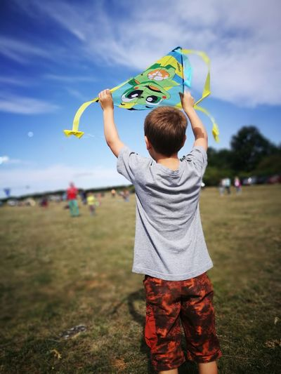 Arms Raised Child Human Arm Children Only One Person Childhood People Sky Outdoors Human Body Part Playing Grass Day Adult Nature One Boy Only Leisure Activity Togetherness Kite Kite Flying Teamwork Nature Airshow Flying Lifestyles