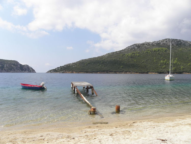Bay Beach Best Beaches Boat Calm Sea Sithonia Day Greece Harbor Harbour Heart Mode Of Transport Moored Mountain Naturalistic Nature Nautical Vessel No People Outdoors Paradise Pier Sailing Seascape Sky Water EyeEmNewHere Live For The Story Your Ticket To Europe Been There. Lost In The Landscape