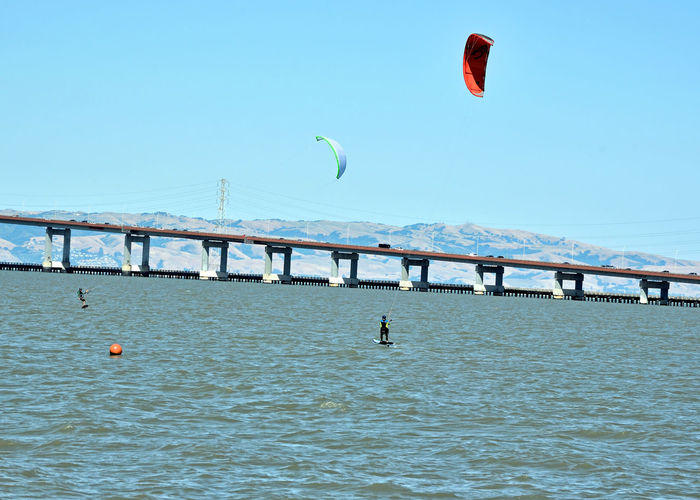 Kiteboarding In San Mateo 20 San Mateo, Ca. Kitesurfers Kiteboarding Board Sports Sports The Color Of Sport Colorful Sails Wind Sports San Mateo Bridge Traffic Marin Headlands Power Towers Power Lines San Francisco Bay Enjoying Life Leisure Activity Course Marker Bridge Span Landscape_Collection Landscape Landscape_photography Nature Beauty In Nature Nature_collection
