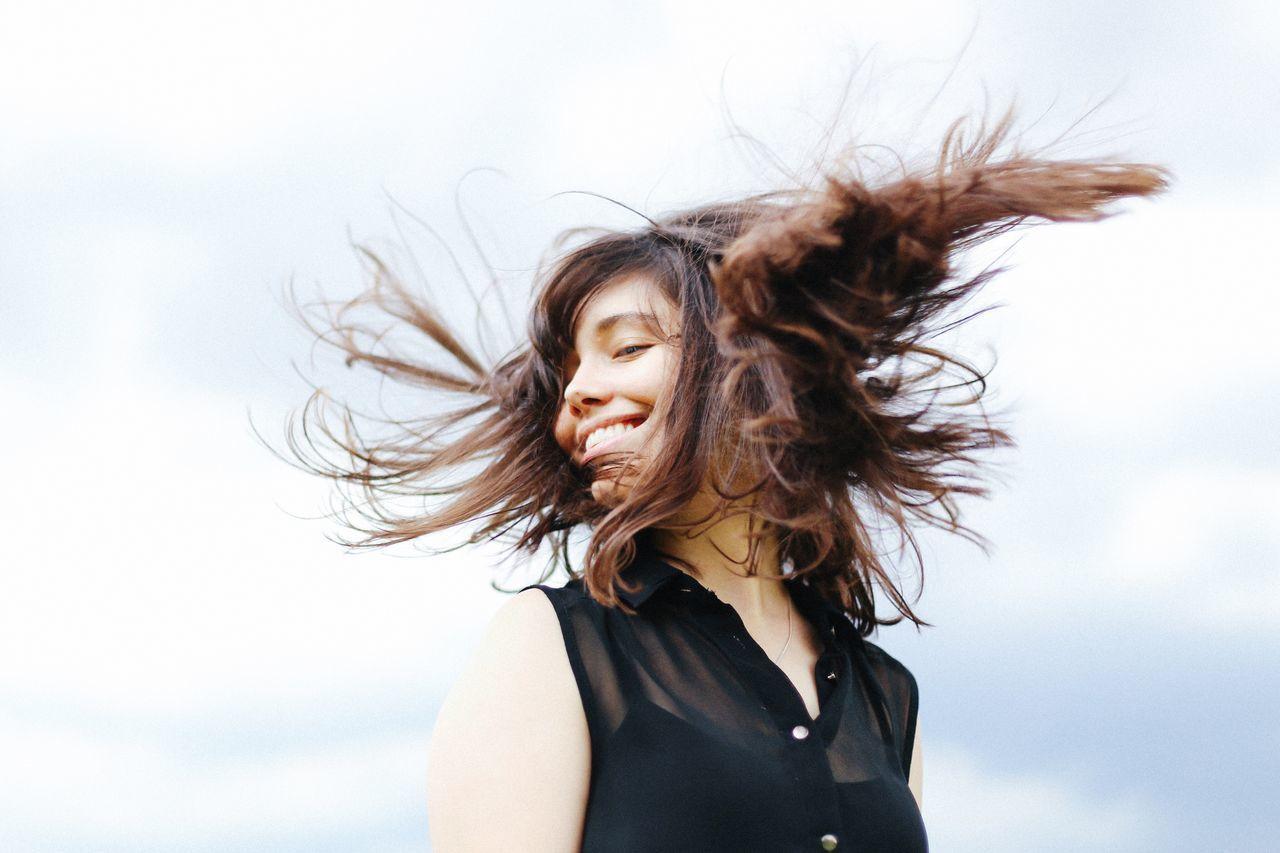 Portrait of beautiful woman against sky