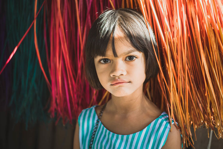 Portrait Of Smiling Girl By Curtain