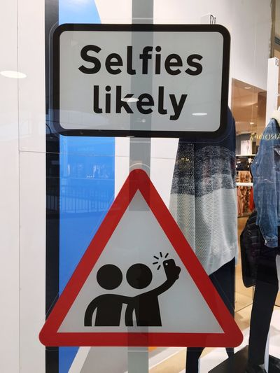 Selfies Likely Window Display. Centre Court Shopping Centre, Wimbledon, England. Photography Communication Sign People Window Display Window Camera Selfie ✌ Text Communication Day No People Road Sign Outdoors Close-up