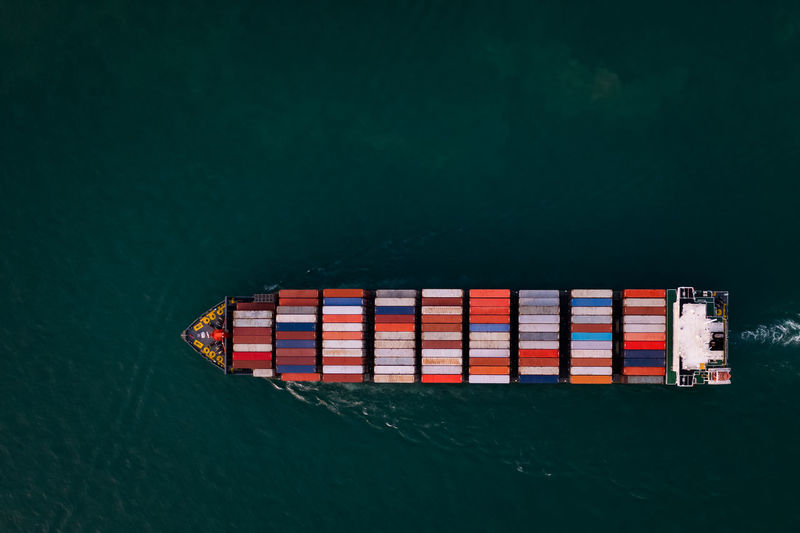 Aerial top view container cargo ship in import export business commercial trade logistic