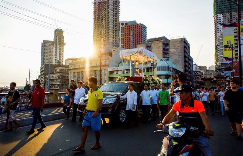 Corpus Christi celebration while capturing the sunset passing through the Binondo Bridge Large Group Of People City Architecture Building Exterior Real People Men Built Structure Skyscraper City Life Outdoors Women Crowd Day Reflective Clothing Cityscape Adult Sky People Adults Only The Street Photographer - 2017 EyeEm Awards Architecture EyeEmNewHere Sunset Reportage