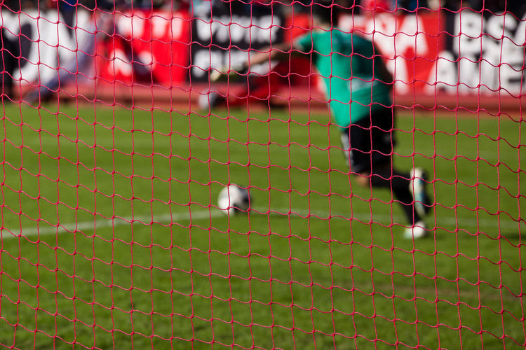 Ball Barrier Bird Boundary Close-up Day Fence Focus On Foreground Full Frame Futbol Goalkeeper Green Color High Angle View Nature Net Net - Sports Equipment No People Outdoors Player Soccer Soccer Ball Soccer Field Sport Team Sport