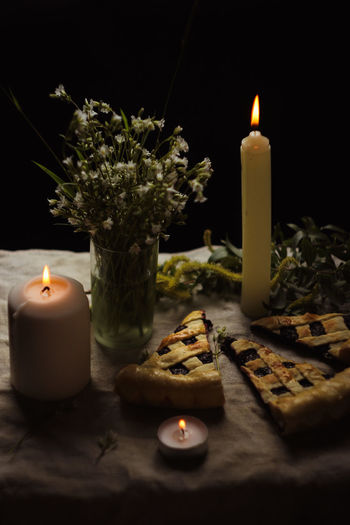 Still life. Pie. Currant pie. Spring still life. Candle Fire Burning Flame Fire - Natural Phenomenon Heat - Temperature Illuminated Nature Indoors  No People Table Selective Focus Glowing Close-up Decoration Dark Still Life Wax Plant Environment Tea Light Melting Candle Candlelight Light Flame