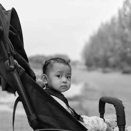 Portrait of cute baby girl in carriage