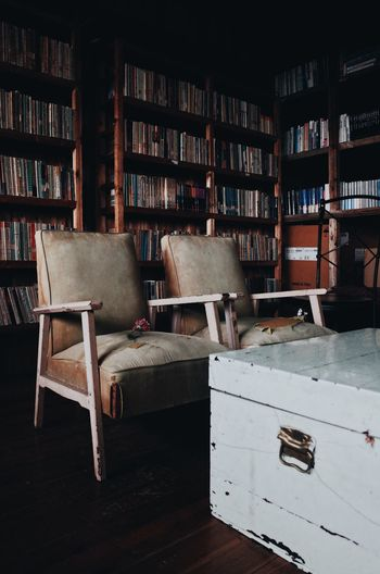 Empty old chairs and tables in library