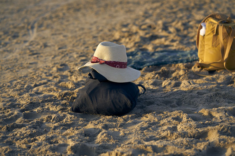 Bag and hat at beach