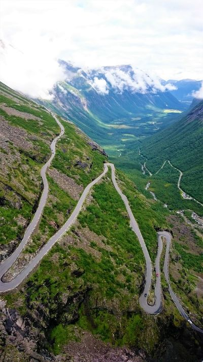 Beauty In Nature Cloud - Sky Curve High Angle View Landscape Mountain Mountain Range Mountain Road Nature Norway Norway Nature Outdoors Road Scenics Sky Tranquil Scene Tranquility Transportation Trollstigen Trollstigen Norway Winding Road EyeEmNewHere Lost In The Landscape Perspectives On Nature