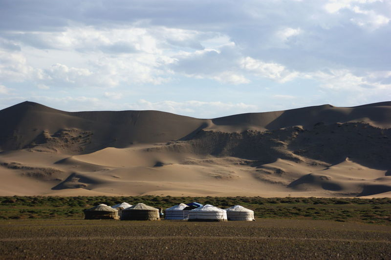 Gobi Desert Khongoryn Els Mongolia Singing Dunes Yurts Arid Climate Beauty In Nature Cloud - Sky Landscape No People Non-urban Scene Outdoors Remote Scenics - Nature Sky Tranquil Scene Tranquility Говь- Монгол улс гэр хонгорын элс