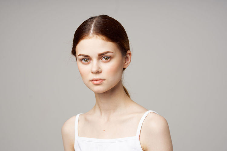 Portrait of a beautiful young woman over white background