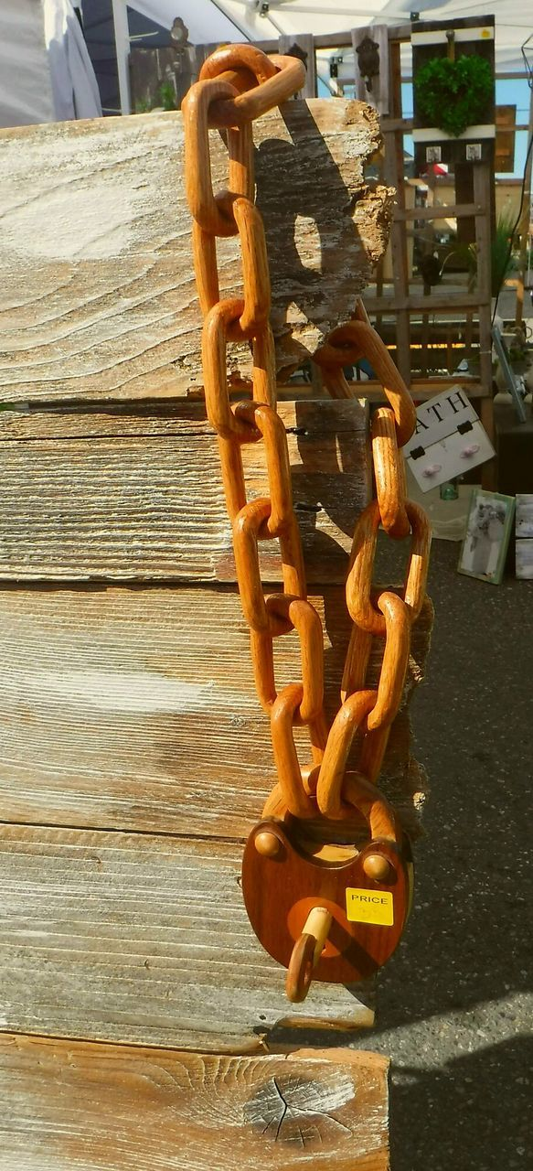 wood - material, metal, no people, rusty, day, chain, focus on foreground, close-up, strength, outdoors, hanging, high angle view, sunlight, brown, still life, connection, equipment, seat, industry, in a row