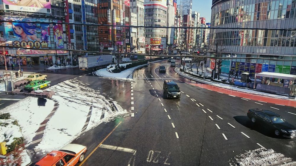 View From Train Window From Train Window Crossing The Road Cars After Snowing Day Reflection Buildings Wintertime Shinjuku Tokyo,Japan Built Structure Transportation Architecture Land Vehicle Outdoors Building Exterior City Road