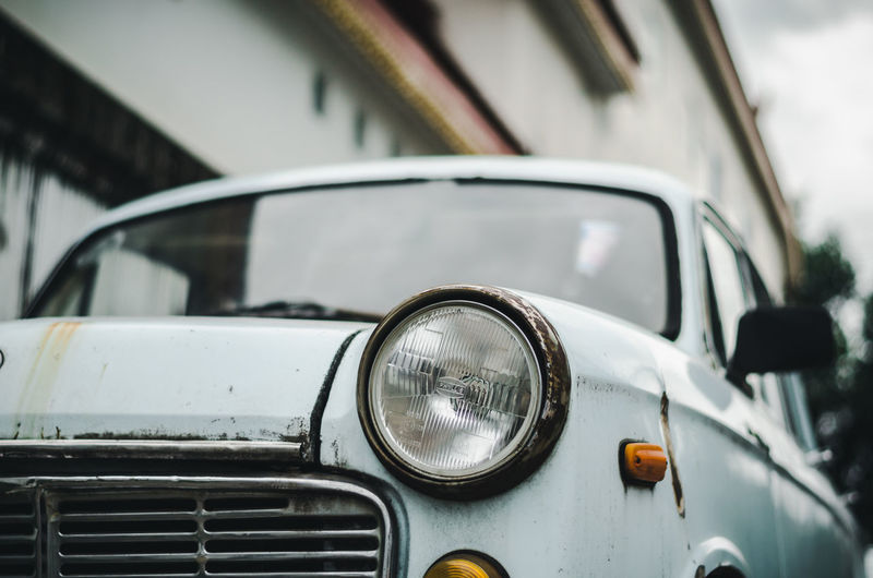 Car vintage in Thailand. Car Close-up Day Focus On Foreground Garage Glass - Material Headlight Land Vehicle Lighting Equipment Luxury Metal Mode Of Transportation Motor Vehicle No People Outdoors Reflection Retro Styled Stationary Transportation Vintage Car Windshield