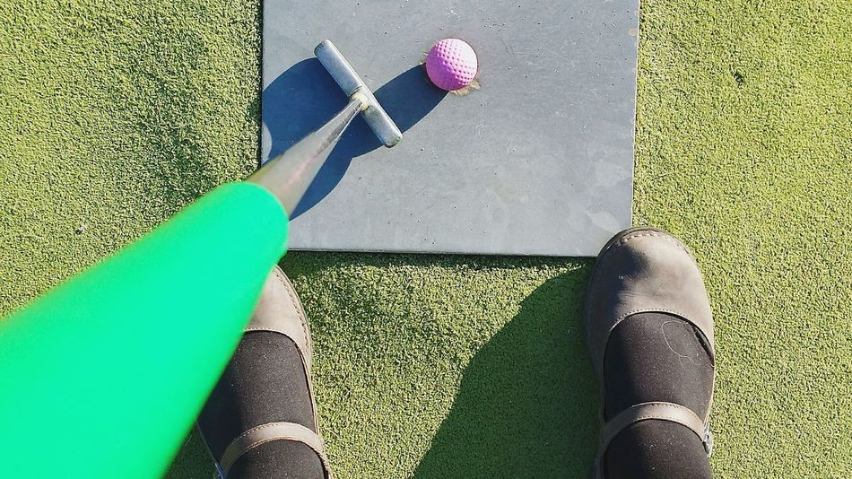High Angle View Grass Green Color Rug Day Sunlight Golf Club Shoe Golf No People Sport Outdoors Low Section Close-up Green - Golf Course Golf Course Minigolf Green Blue Pink Color Colorfull Golfball Abschlag Einlochen Handicap