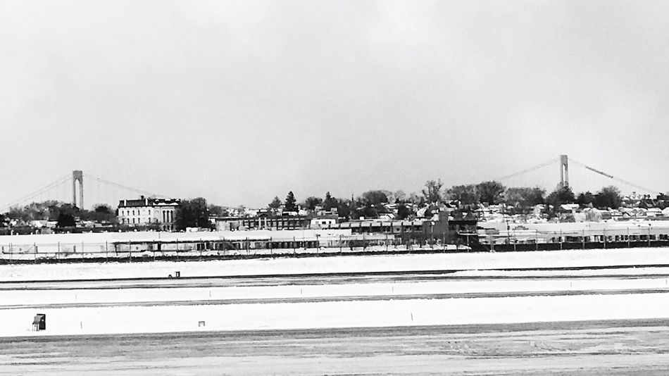 Cold Temperature Snow Winter Architecture Blackandwhite Blackandwhite Photography Travel NYC Airplaneview Queens NYC Queens Laguardia Laguardiaairport Built Structure Throgsneckbridge Throggs Neck Bridge picture taken from airplane on the tarmac the day after the snow storm, 2017. Throggs Neck Bridge in background. EyeEmNewHere EyeEmNewHere Adapted To The City Adapted To The City TCPM Black And White Friday
