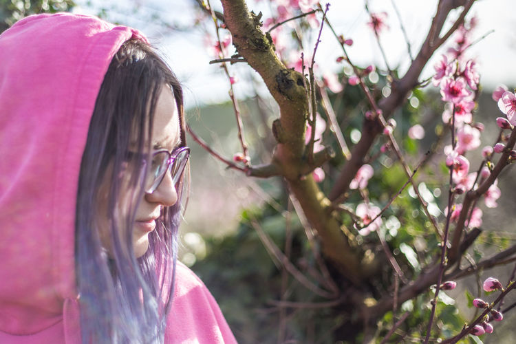 Solar Sunlight Sunny Day Girls Hairstyle Headshot Innocence Lifestyles Nature One Person Outdoors Pink Color Plant Spring Spring Flowers Springtime Sunny Day Tree Women The Portraitist - 2018 EyeEm Awards