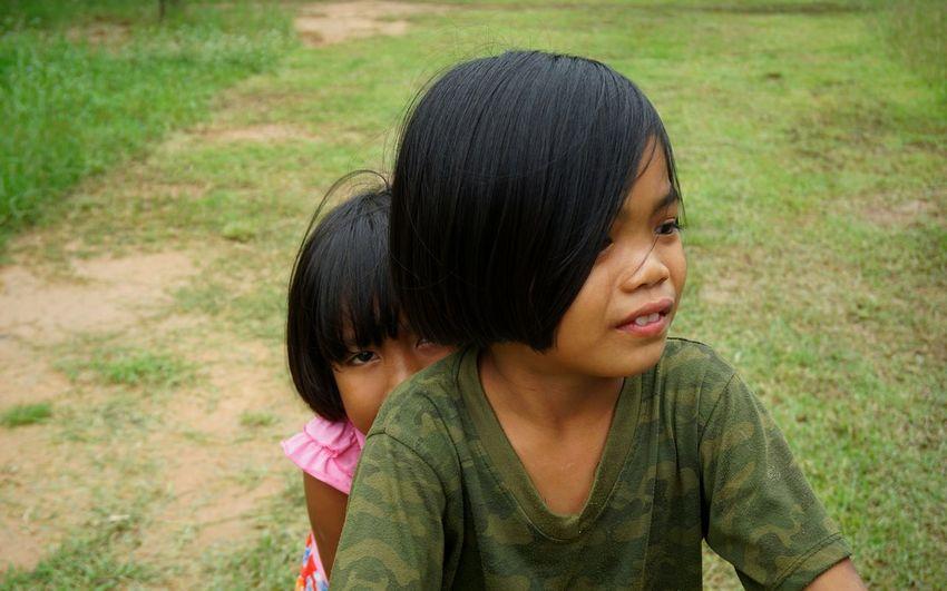 Portrait of a girl looking away on field