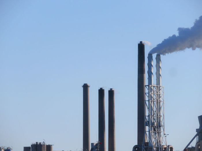 Factory Industry Clear Sky Smoke Stack Business Finance And Industry Fumes Blue