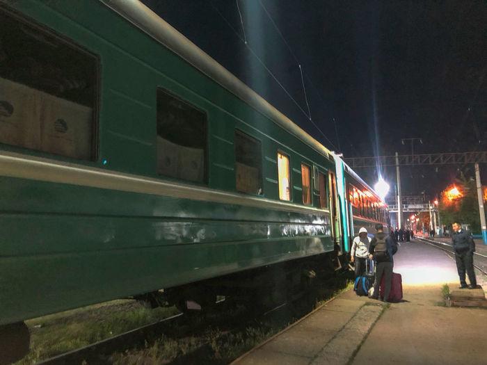 Boarding the night train at Almaty Central Station, Kazakhstan City Illuminated Mode Of Transportation Night Rail Transportation Railroad Station Railroad Track Train - Vehicle