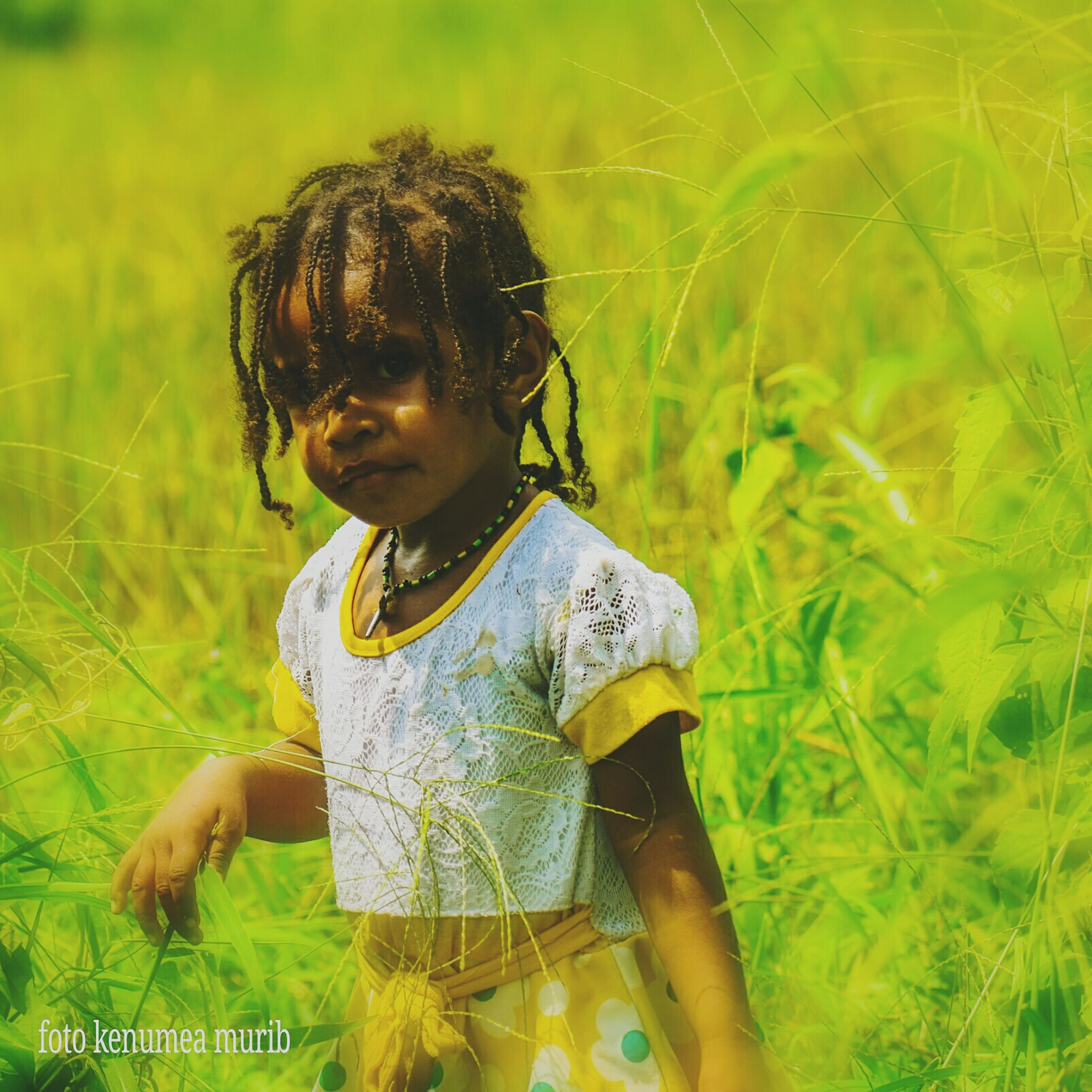 child, childhood, real people, girls, leisure activity, one person, plant, females, land, field, women, grass, cute, lifestyles, day, innocence, nature, casual clothing, outdoors, hairstyle