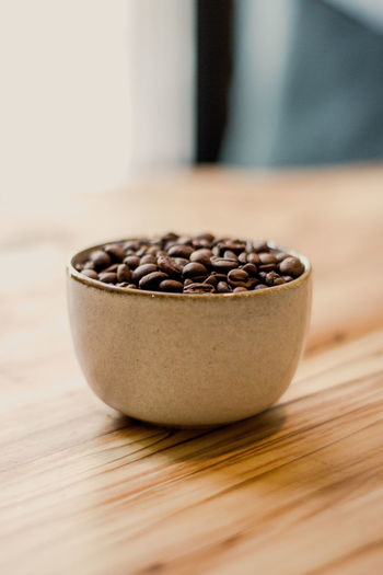 Table Food And Drink Freshness Indoors  Close-up Brown Food Wood - Material No People Selective Focus Bowl Seed Raw Food Still Life Coffee Coffee - Drink Wellbeing Healthy Eating Roasted Coffee Bean Kitchen Utensil Wooden Spoon Wood Grain Caffeine Luxury