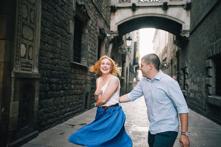 Cheerful Couple Dancing In Alley